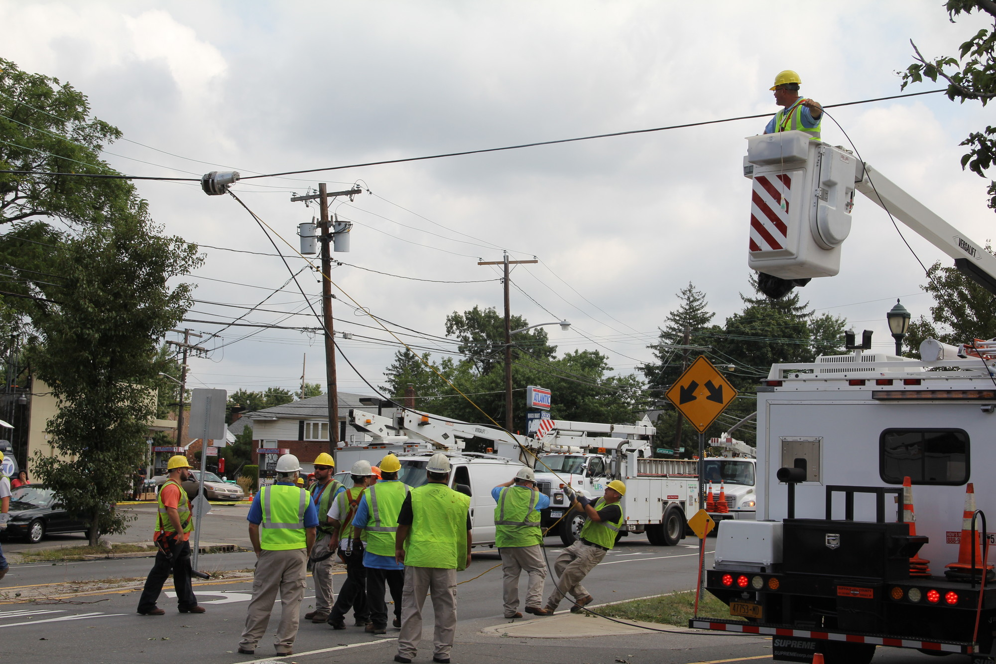 Utility crews work to repair the damage along Dutch Broadway in North Valley Stream on Tuesday.