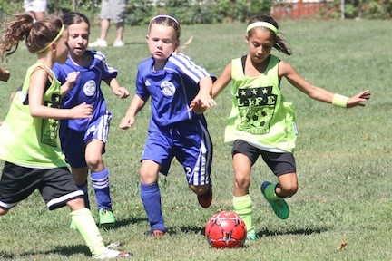 The East Meadow Soccer Club devotes one of its younger brackets to the charity Melissa's Rainbow of Joy, named after Melissa Siegel, an East Meadow girl who died 10 years ago. Above, Ella Maldonado, right, won a race to a loose ball.