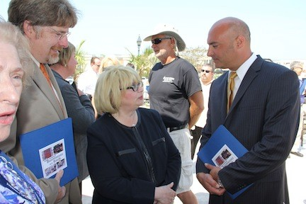 Glenn Ingoglia (right), the president of the Island Park chamber of commerce, has announced his plans to run for village mayor. Ingoglia is pictured at a recent Sandy recovery event in Freeport.