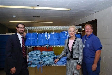 East Meadow resident Ben Diamond, left, worked with NUMC's Chief Compliance Officer Karen Leslie and laundry director Walter Lazauskas to prepare scrubs to send to troops in Afghanistan earlier this month.
