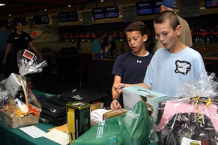 Friends Connor Langdon and Dylin Rhoades marveled at the sports memorabilia being raffled off.