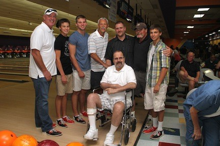 Marty Lyons, left, his sons Luke and Jesse, Kenny Schroy, Andrew Ghirardi, John Gordon and Dillon Massaro, with Paul Caniglia, during the 19th Annual Nassau Bowling fundraiser at East Meadow Lanes on Aug. 16.