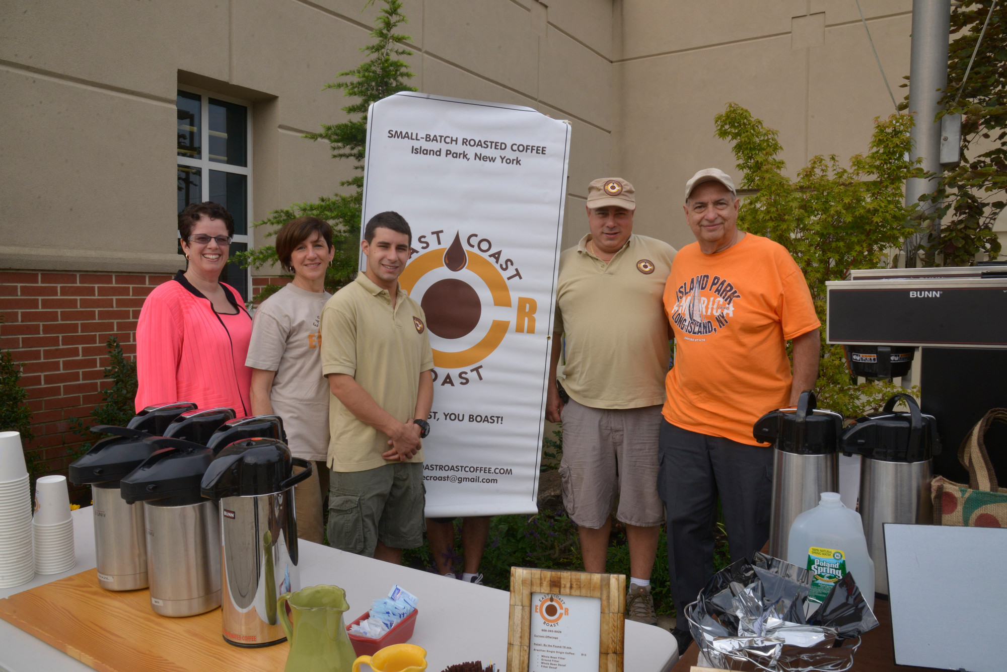 Library director Jessica Koenig (left), Richard Maryanne and John Comuniello  from East Coast Coffee, the company that donated coffee for the event, with library trustee Joe Ponte at the community welcome ceremony last week.