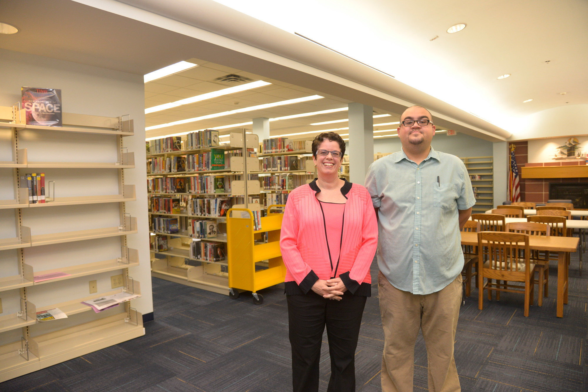 Library director Jessica Koenig and Antonio Cuneo, a library aide  who has worked at Library since he was 16.