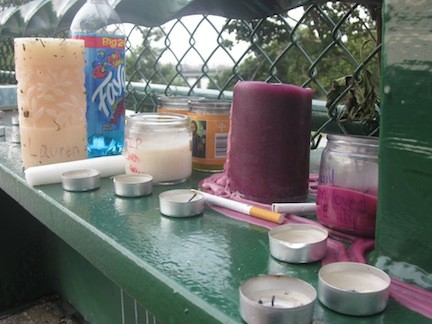 Friends left candles on the footbridge where Daverin-Gresham was killed.