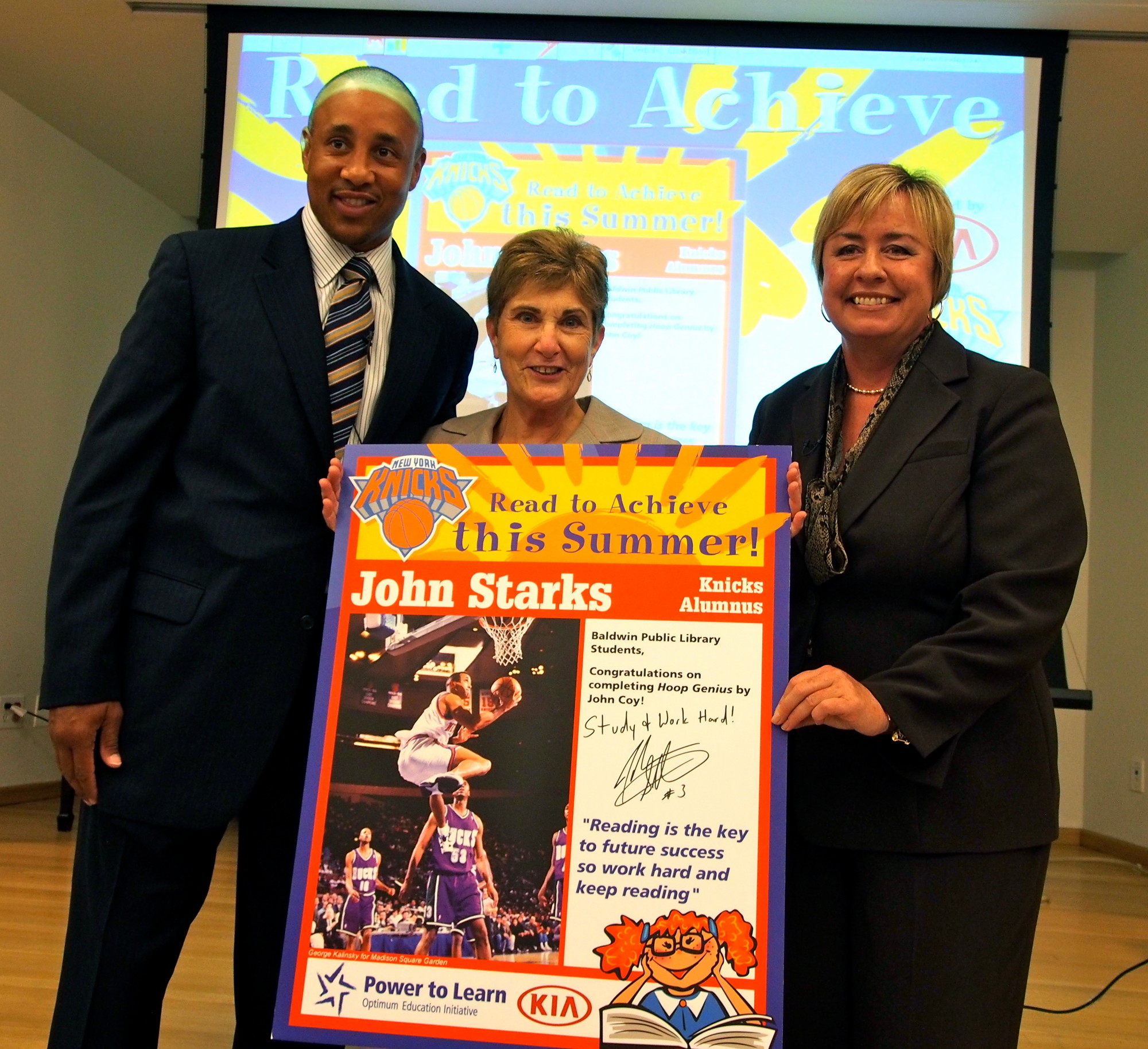 Catherine Overton, pictured center with former Knicks guard John Starks and Town of Hempstead Supervisor Kate Murray at a summer reading promotion, is leaving the director's position at the Baldwin Public Library on Sept. 6.