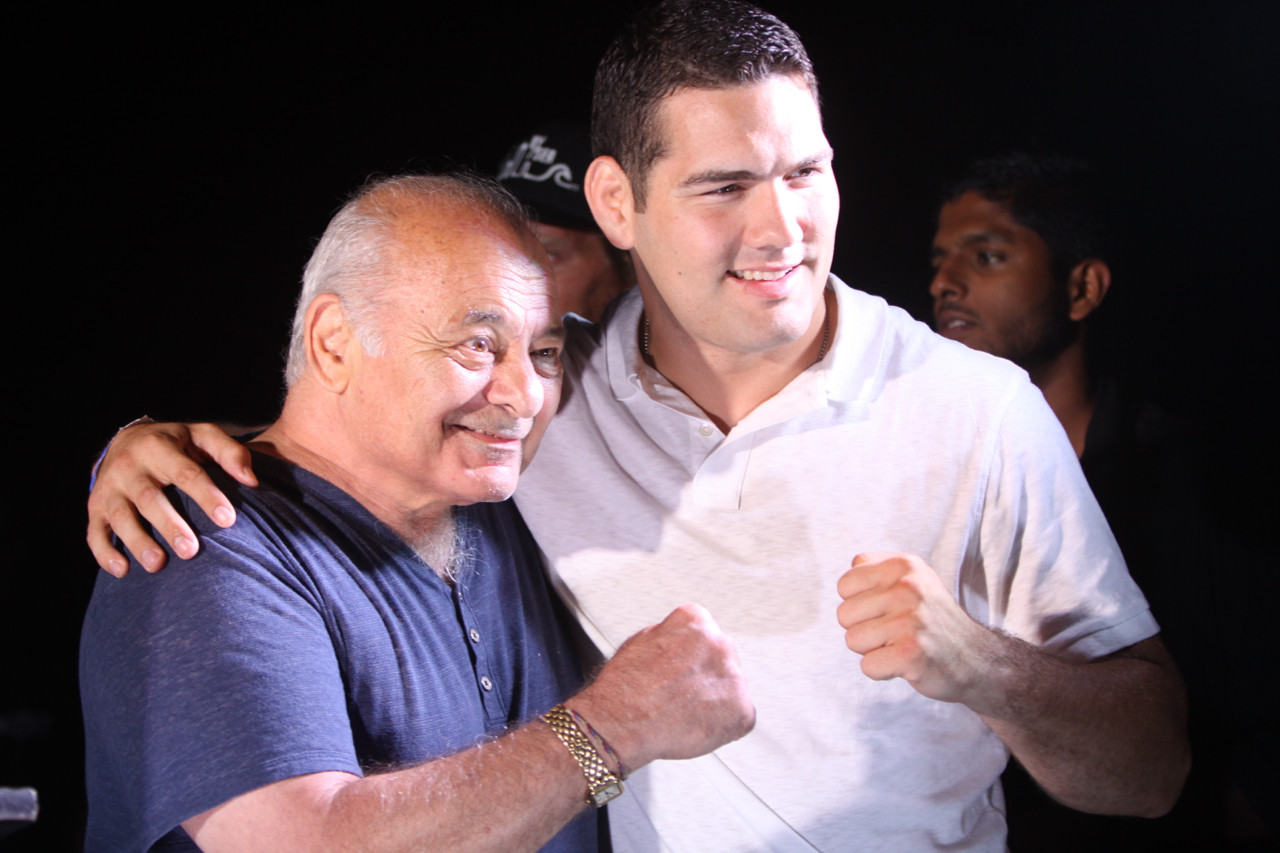 "Actor Burt Young, left, who played Paulie in the ""Rocky"" films, and UFC champ Chris Weidman honored Long Beach residents for their perseverance after Hurricane Sandy at the Long Beach International Film Festival on Aug. 22."