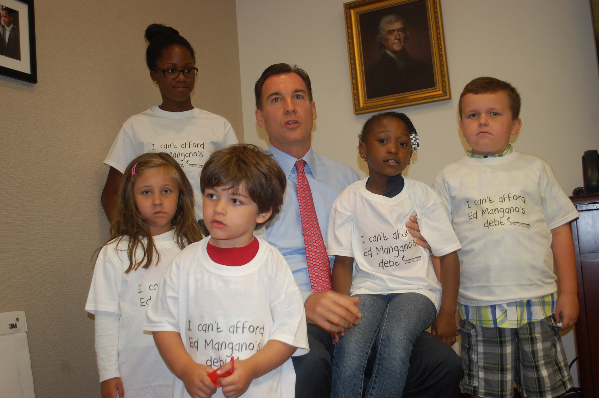 "Tom Suozzi introduced some of the children who starred in his newest commercial, ""Counting,"" which criticizes the financial practices of current County Executive Ed Mangano. Suozzi is hoping to win the Democratic primary on Tuesday, which would setup a rematch with Mangano in November."