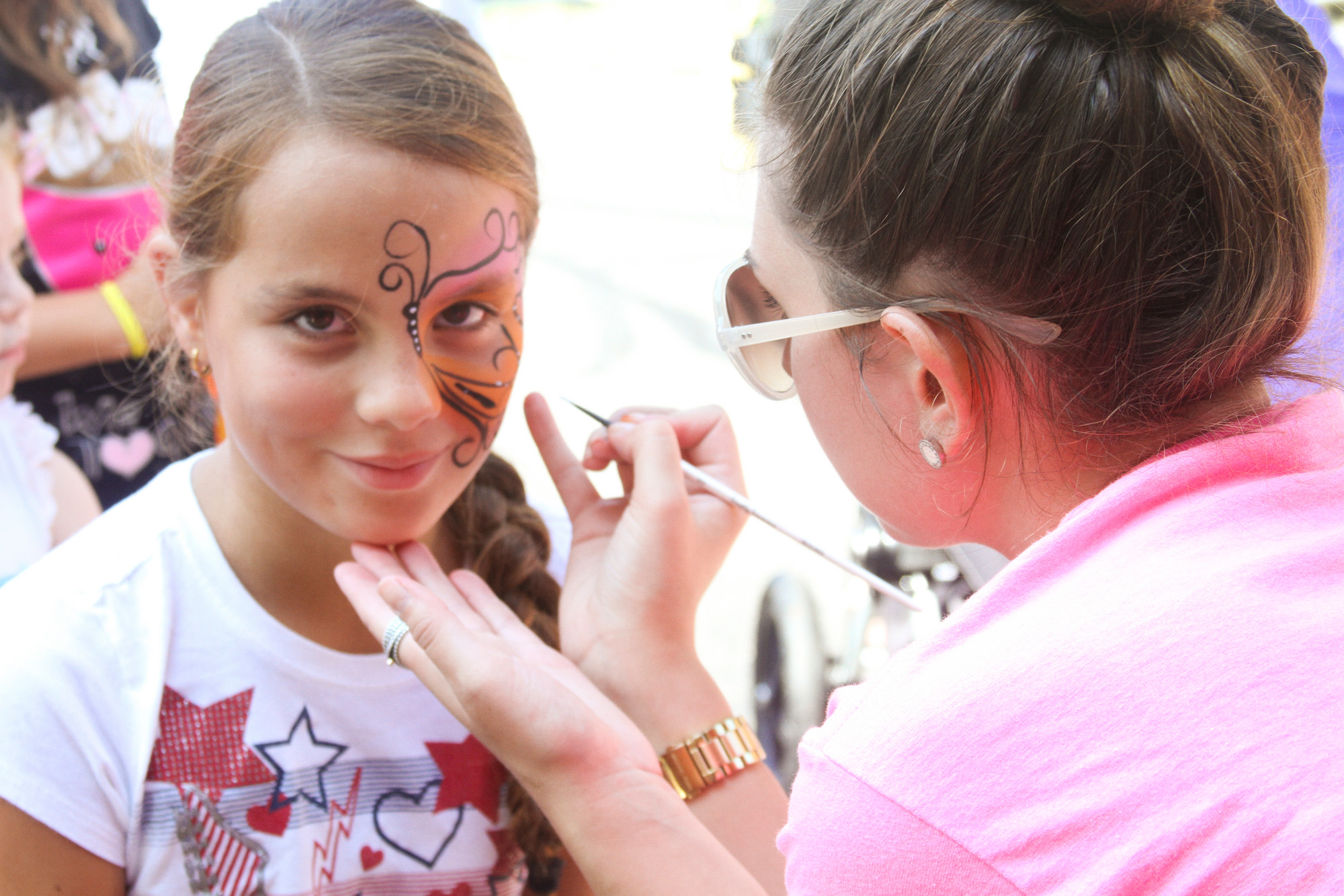 Daniela Andrade, 9, got her face painted by Briana C. from Twinkle Town.