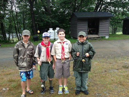 They were prepared: Boy Scouts Dan Schroeder, far left, Jack Kelly, Dan Varney and Luis Jimenez-Franco, of Rockville Centre's Troop 40, readied for a day of fishing, swimming, and hiking at Onteora Scout Reservation in Livingston Manor, N.Y.