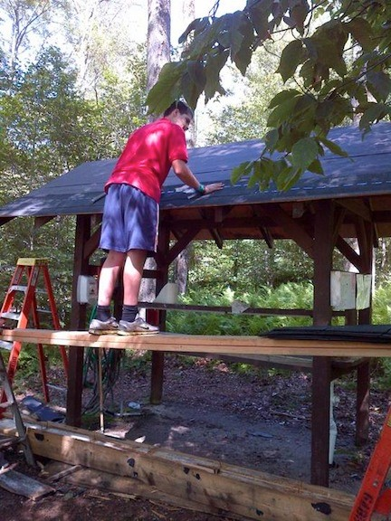 Owen Clark helping with wash station roof repairs.