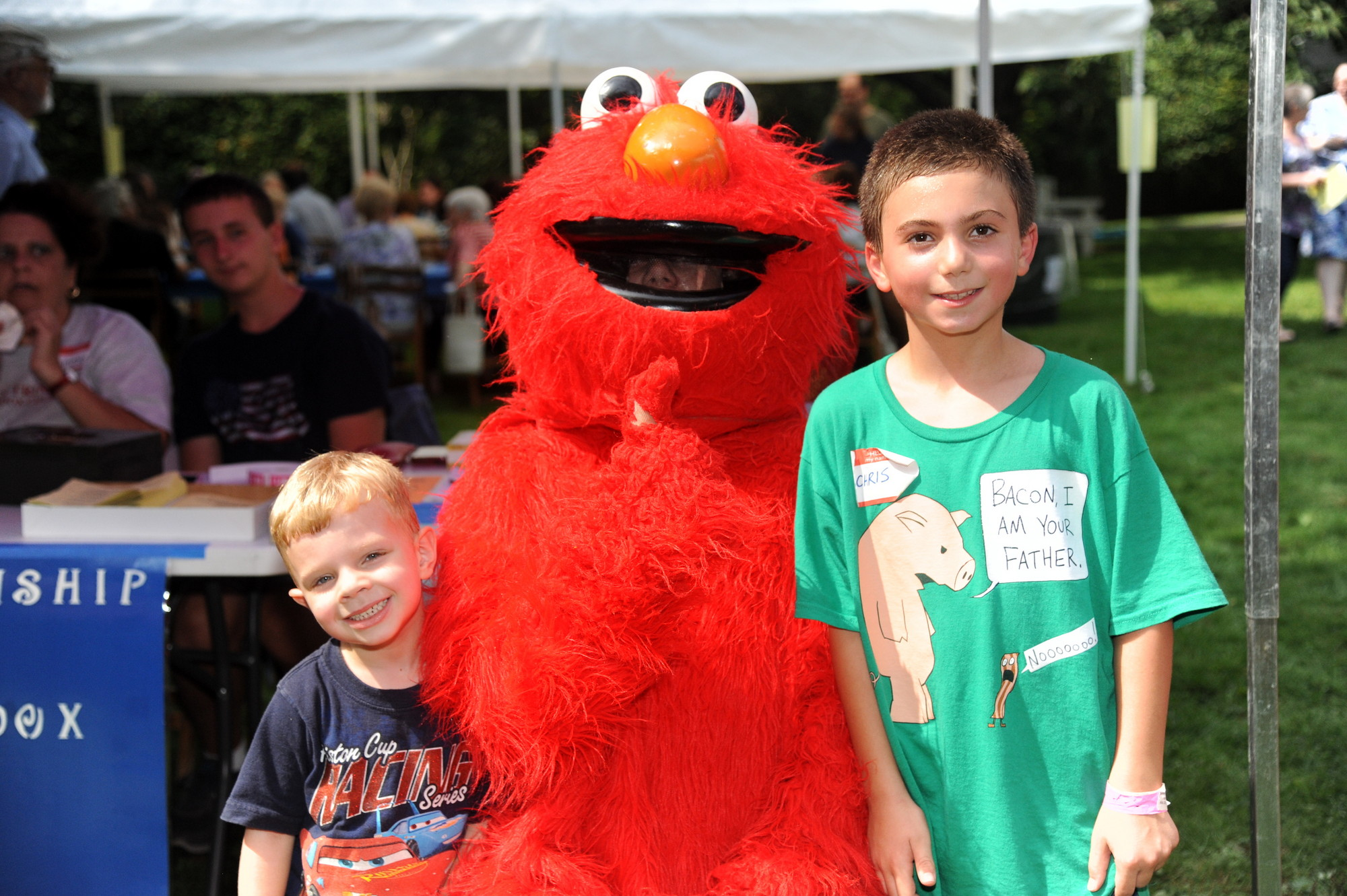 Colin Jenks, 4, left, and Christopher Ignatiou, 9, did not miss the opportunity to pose with Elmo during the Holy Trinity Orthodox Church's Faith, Food & Fellowship Festival last Saturday.