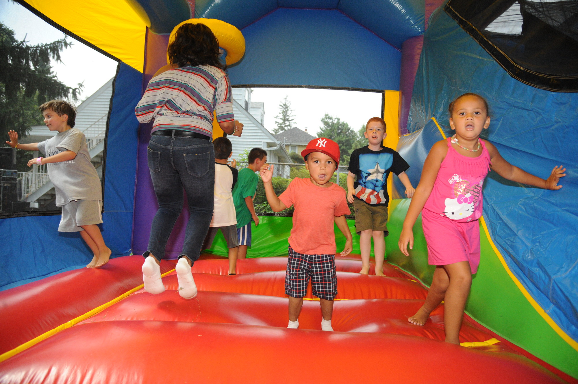 Seander Turman, 4, middle, and Julia Tabron, 6, enjoyed jumping around a bouncy castle, situated on the church's Green Avenue lawn.