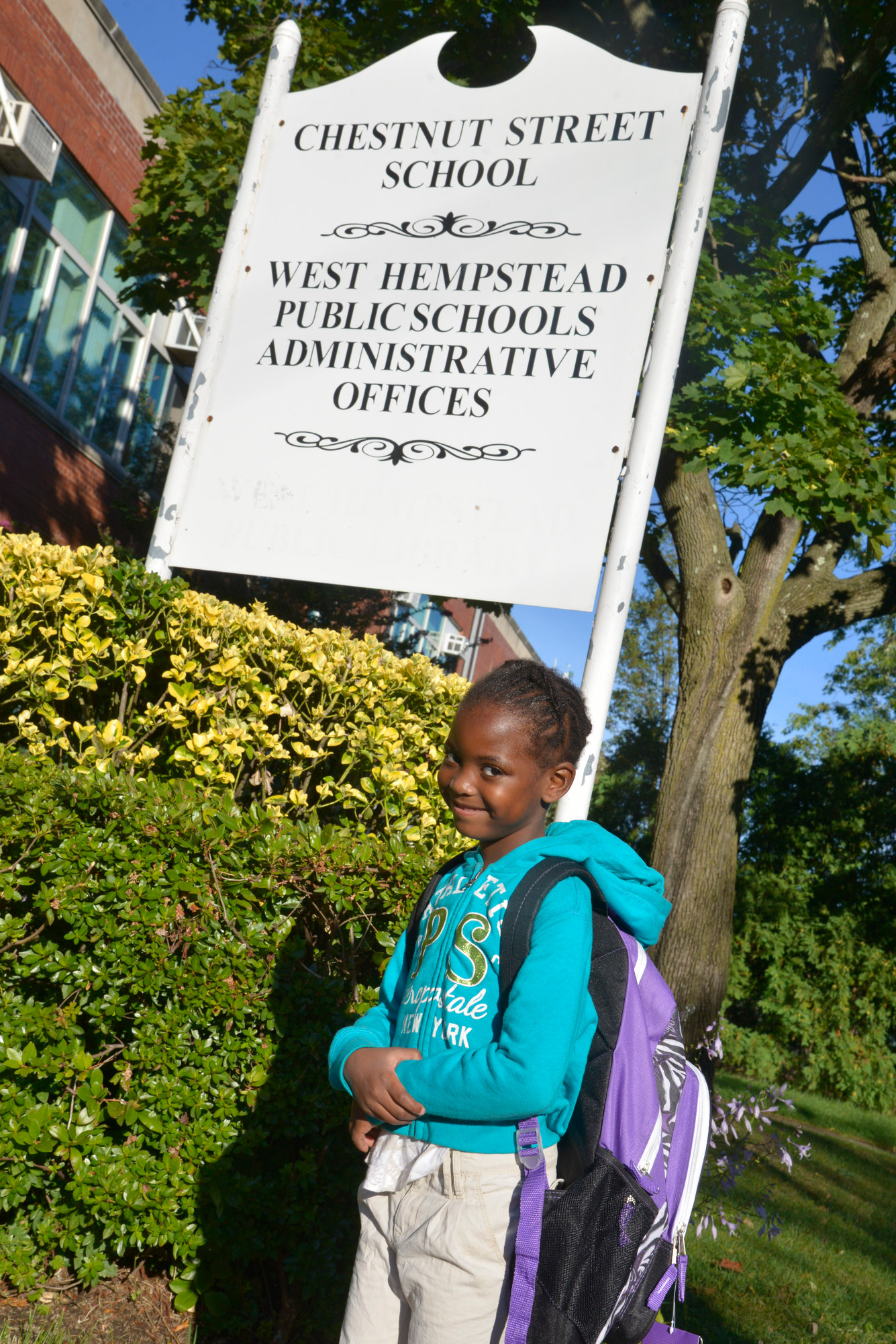 Nylah Fye, 5, prepared to walk through the doors of Chestnut Street School.