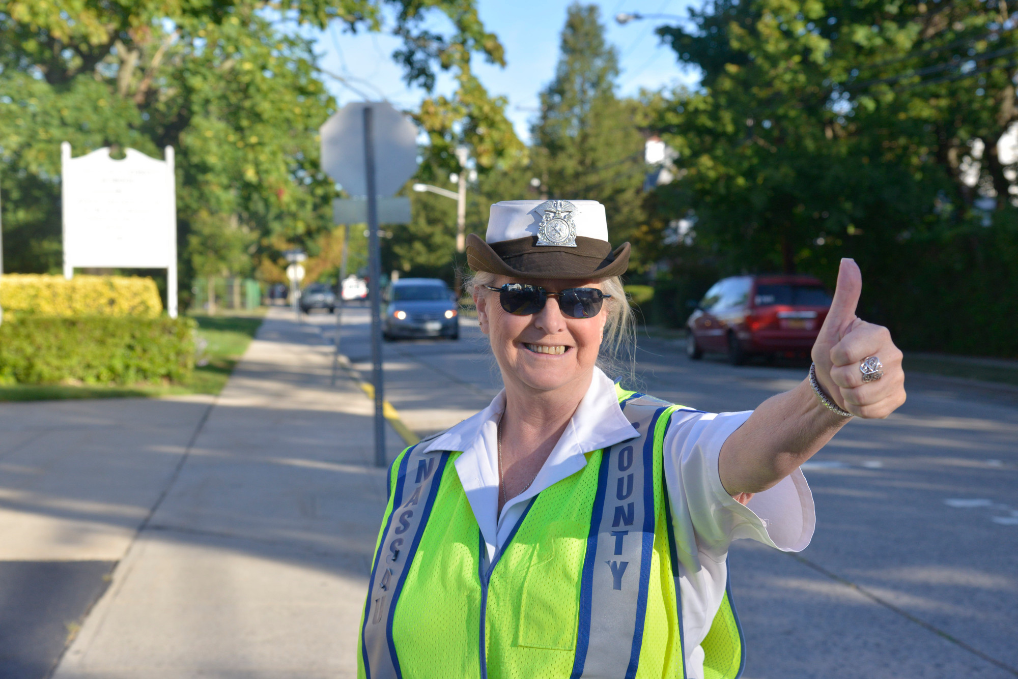 Sue Tirino, a crossing guard for 24 years, gives this new school year a thumbs up.