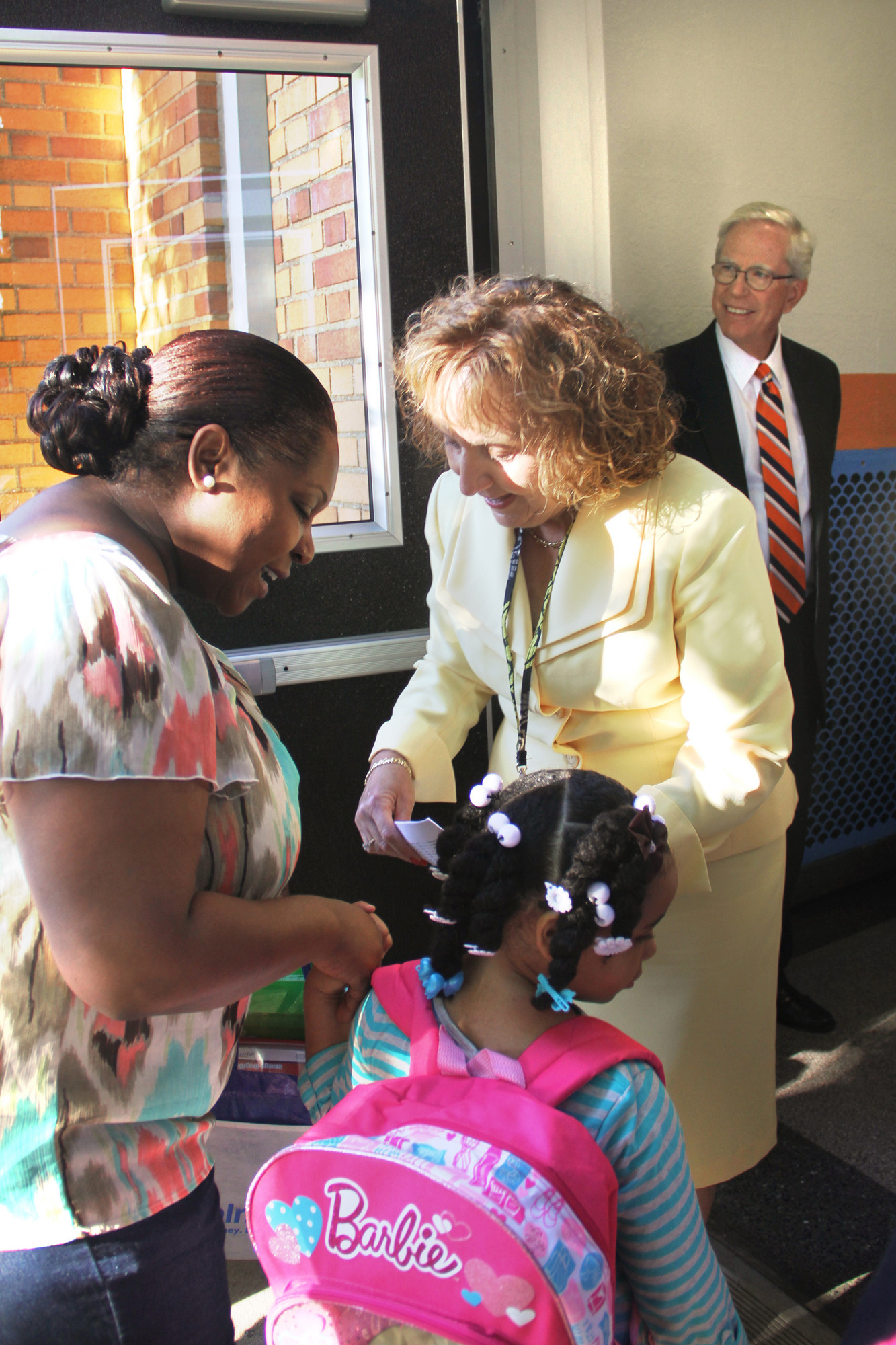 Principal Margaret McDaid and Superintendent Dr. James Hunderfund greet Danielle Johnson and her mom on the first day of school.