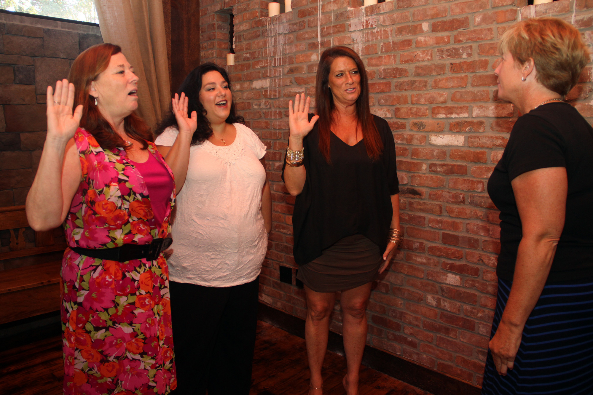 Mayor Patti McDonald swears in Rotary Club President Kathi Monroe, Secretary Anna Marie Redmond and Treasurer Judi Puma.