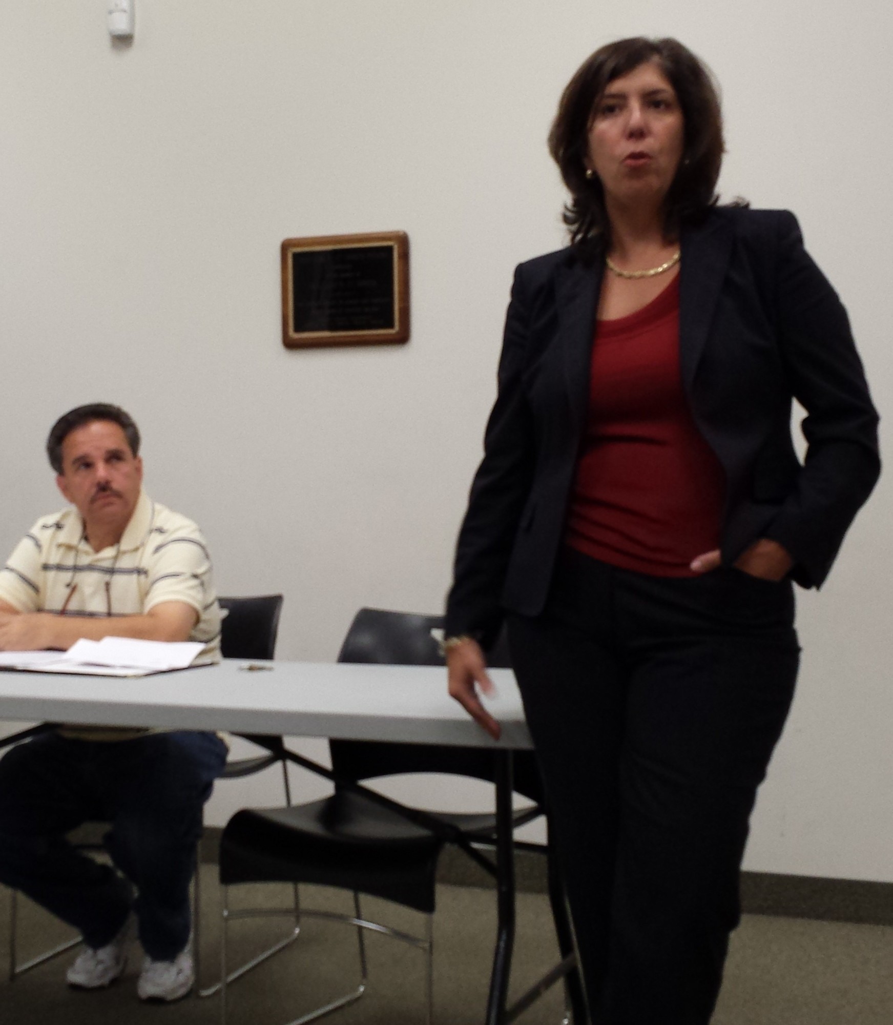 Chief Assistant District Attorney Madeline Singas visited Elmont Library on Sept. 3 and addressed community concerns about safety as Elmont East End President Patrick Nicolosi listened.