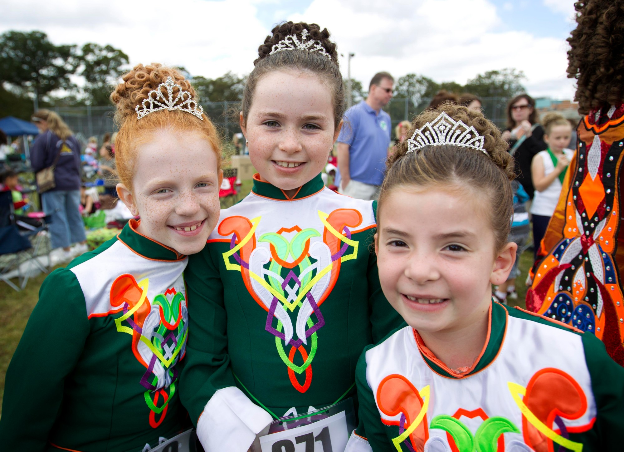 These young ladies are full of smiles as they share in the cherished traditions that are preserved and honored at the feis.