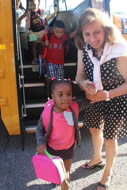 Kaitlin Hamilton was greeted by Willow Road School Principal Stephanie Capozzoli as she emerged from the bus for her first day of kindergarten.