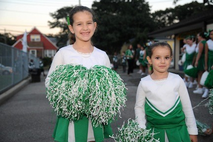Emily Bevis, 7, and sister Stephanie, 5, will be rallying support for the Green Hornets this year.