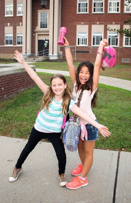 Evelynne Baldino, 8, left, and Kaetyln Lee, 9, were excited for their first day as fourth graders. This was Kaetyln's first day of school in Island Park. She just moved with her family from Chicago.