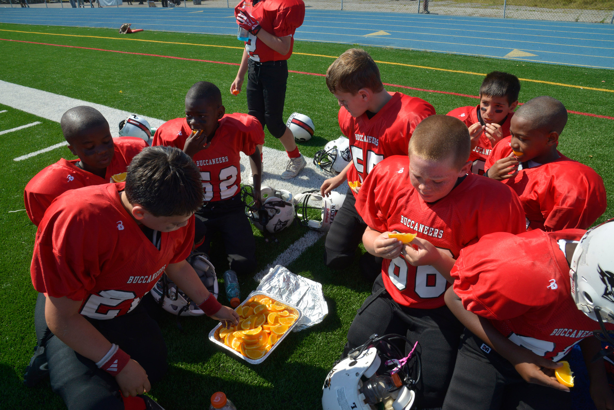 Buccaneer players took a game break to regain their energy by snacking on orange slices.