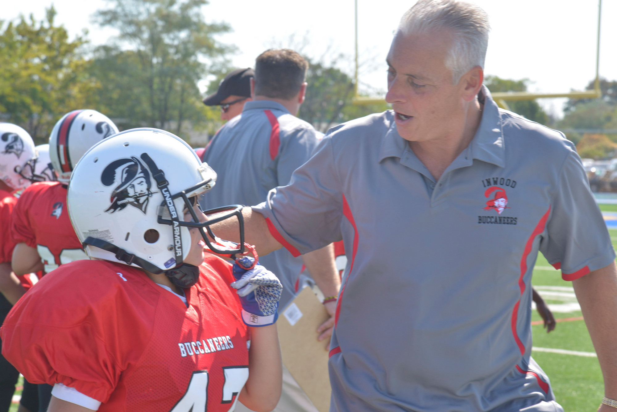 Inwood Buccaneer Day was part competition and part football education. Coach Frank Ruta shared some knowledge with John Cusumano.