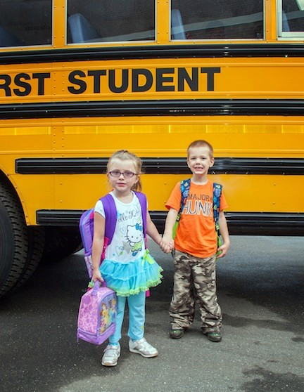 Ava Acovino and Jarred Moore get off the bus together. They will be attending kindergarten.