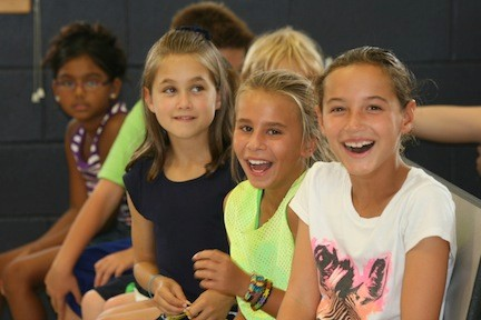 Fourth graders Samantha Weintraub, Samantha Olewnicki and Brenna Haufler are old hands at the first day of school.