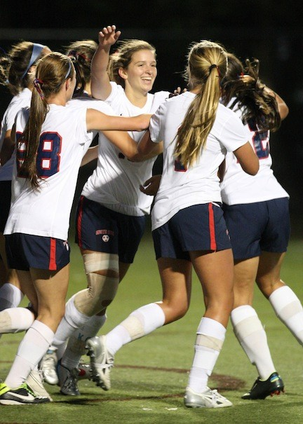South Side's Jessica Hawley, center, celebrates with teammates after scoring a goal in Monday night's 3-0 win over Sacred Heart.