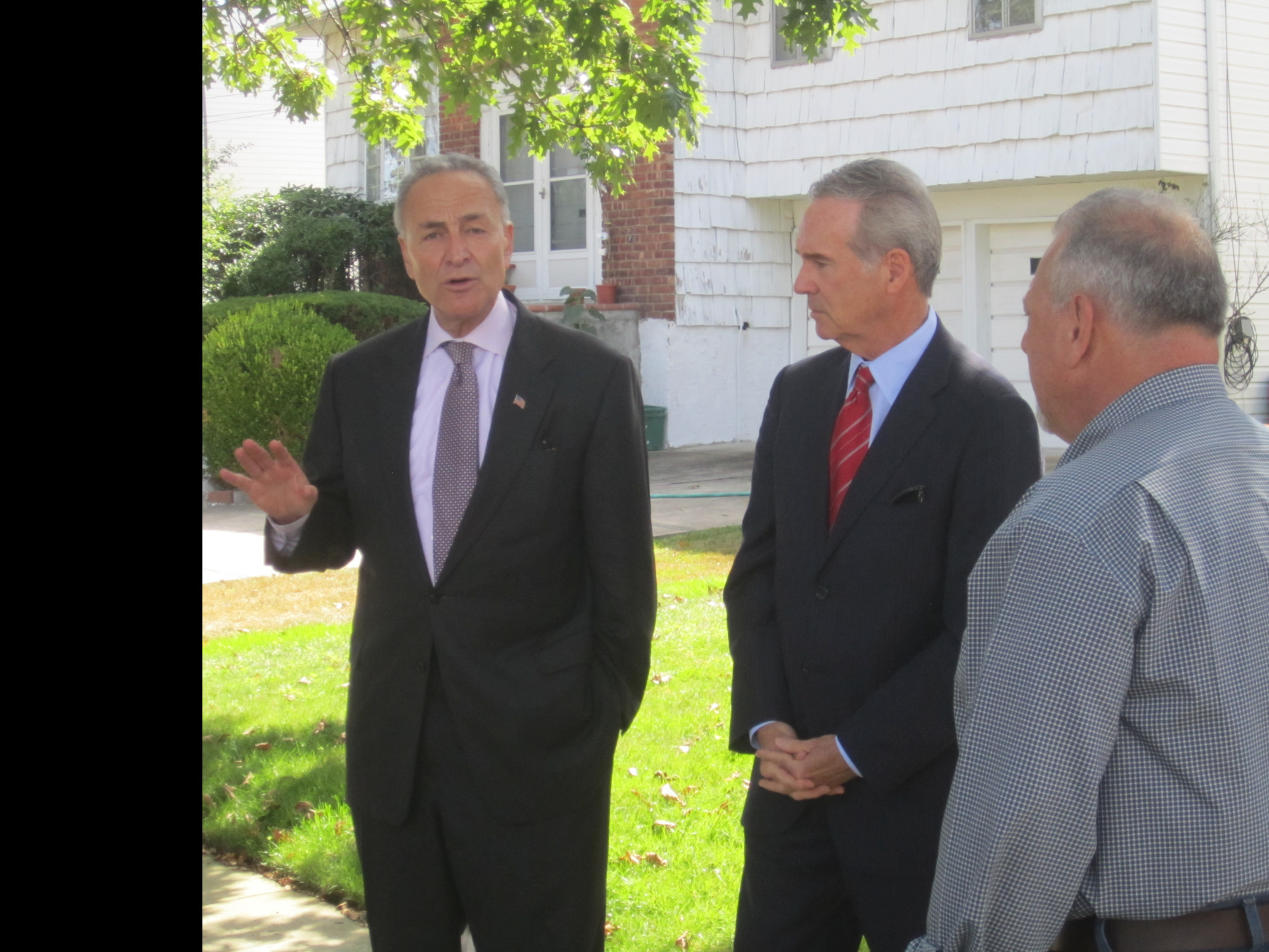 John Cameron Jr., chairman of the Long Island Regional Planning Council, center, joined Schumer at the news conference, and spoke briefly in support of the senator's proposal.