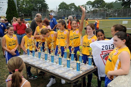 The Lady Rebels took a first look at the trophies and plaques that the North Bellmore-North Merrick Little League gave them and their coaches in an Aug. 31 ceremony at Gunther Field in North Bellmore.