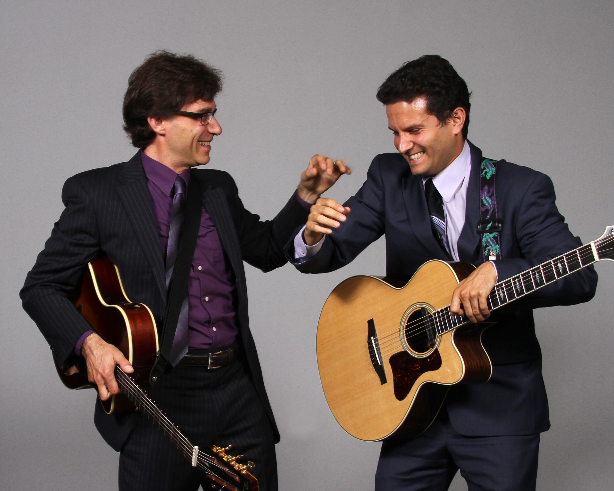 Renowned jazz guitarist Frank Vignola (left) demonstrates his musical versatility with Vinny Raniolo when the duo appears at the Long Beach Public Library on Sept. 21.