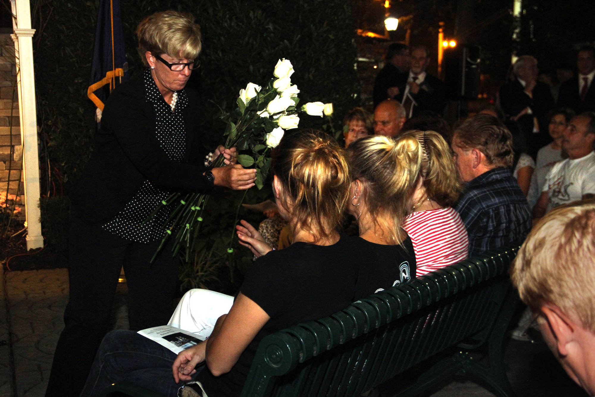 Mayor Patti McDonald distributed flowers to the victims' families to place on the memorial.