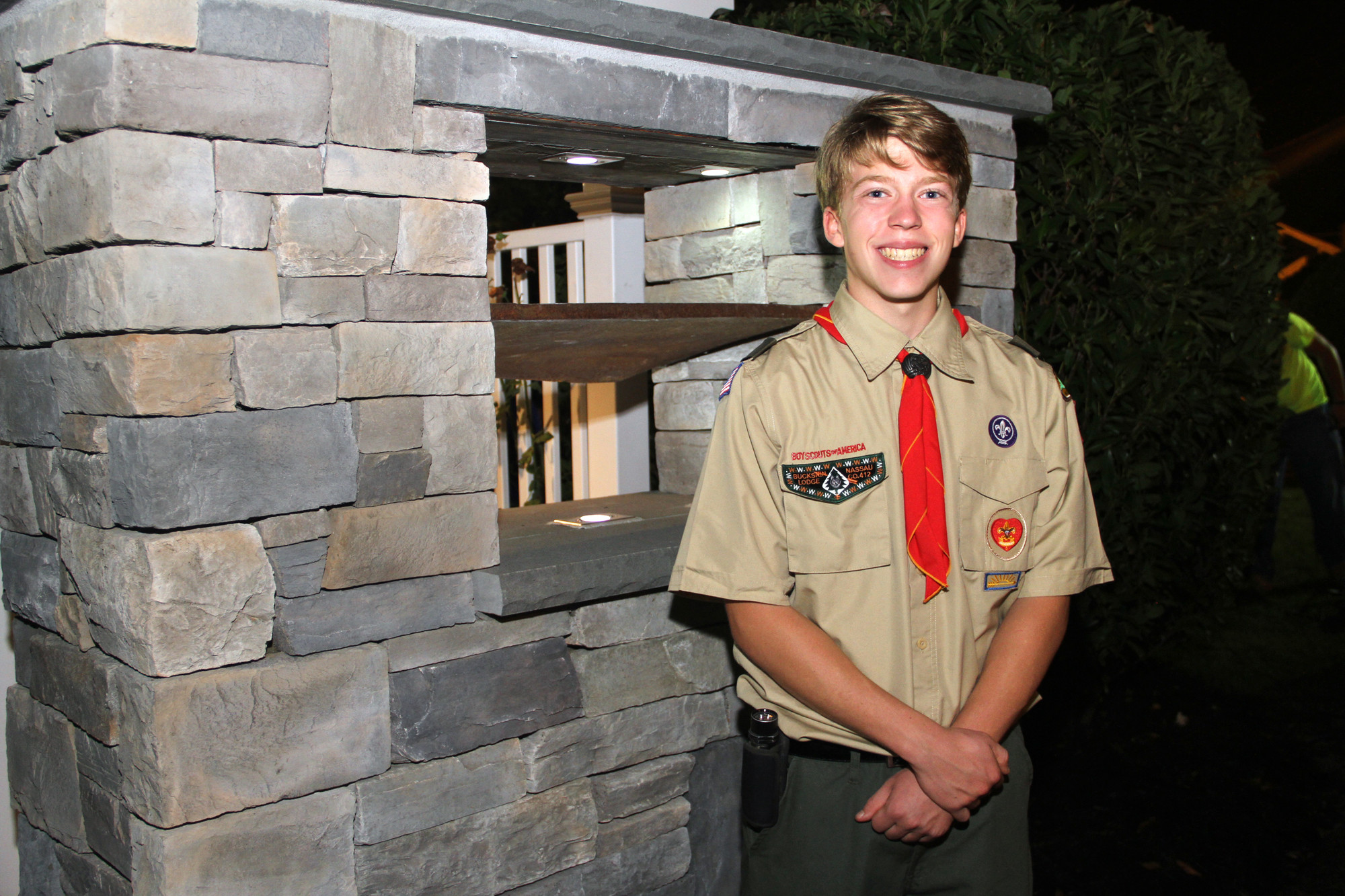 Troop 24 Boy Scout Nicholas St. John unveiled his Eagle Scout project before the memorial service.