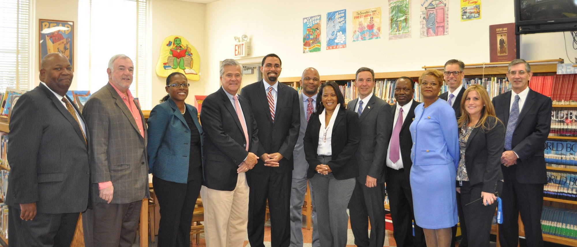 State Commissioner of Education Dr. John B. King Jr., center, gathered for a photo with school district officials and board members on Sept. 9.