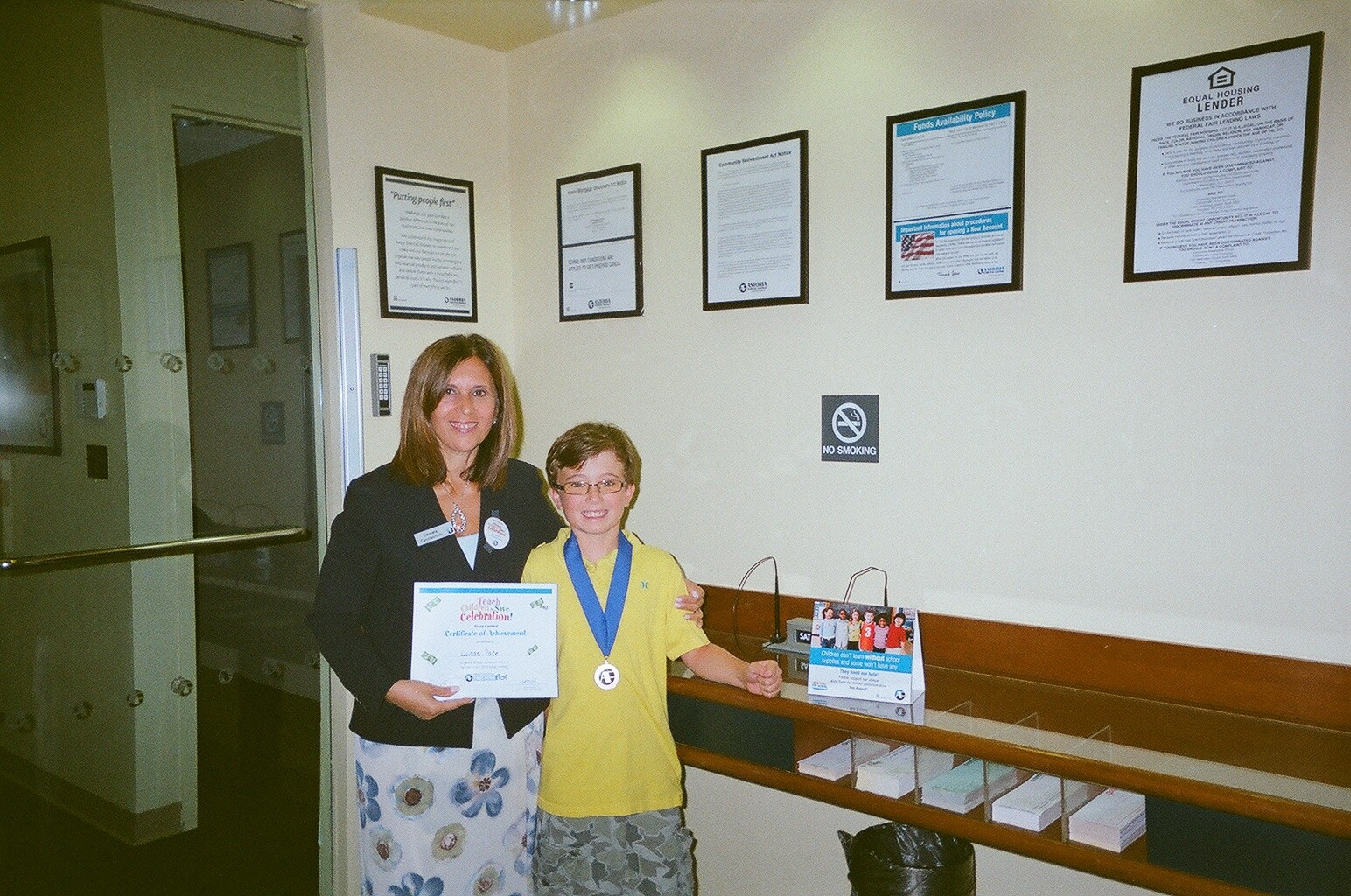 Astoria Federal Savings Essay Contest Winner Lucas Pace is presented with his award from Astoria Federal Oceanside Branch Manager and Vice President, Banking Division Carmela Cacciuottolo.