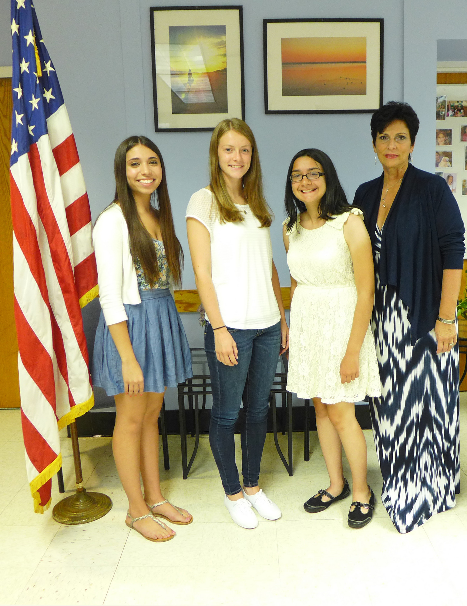 The three OHS seniors who earned semifinalist status in the prestigious National Merit Scholarship process are, from left, Brittany Kwait, Marissa Colasacco and Stephanie Nagel. They are pictured with new Oceanside High School Principal Geraldine DeCarlo.