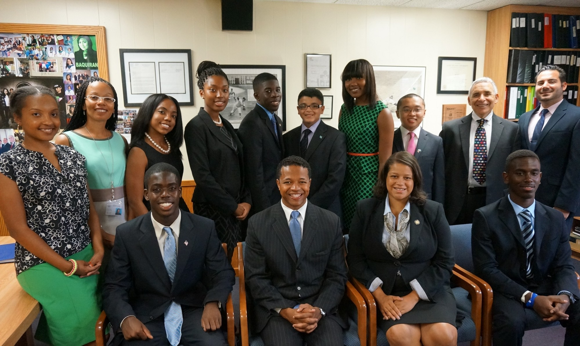 Michael Bediako, front left, Nassau County Legislator Carrie Solages, Assemblywoman Michaelle Solages, Darnell Marescot, chaperone Athena Allen, back left, EMHS MUN Co-advisor Nkenge Gilliam, Ashley Reese, Mykelle Richburg, Chukwudi Kanu, Isaiah Genao, Leanna Faulk, Christian Butron, EMHS MUN Co-advisor Melvin Kohn and chaperone Frank Nuara gathered for a photo during the Solages' visit to Elmont Memorial High School on Sept. 10.