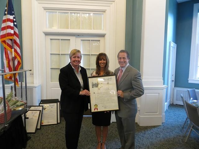 Franklin Square resident Krista Testani, center, was honored by State Assemblyman Brian Curran as a woman of distinction on Sept. 7. Hempstead Town Supervisor Kate Murray also attended the ceremony at the Lynbrook Public Library, which featured 13 other honorees from neighboring communities.