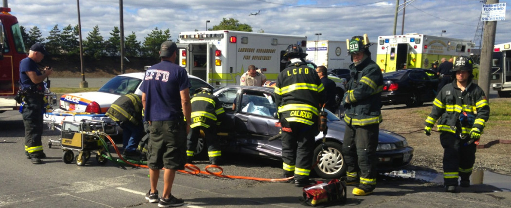 Three people were injured and one woman had to be extricated from a vehicle after a two-car crash in Lawrence.
