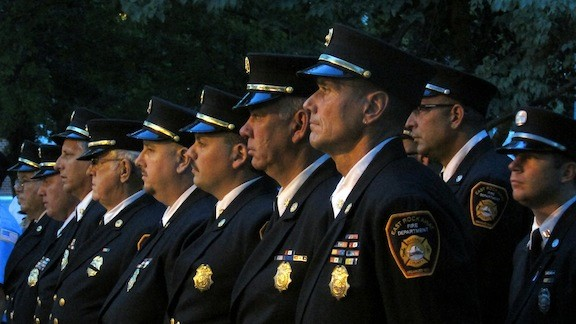 East Rockaway and Lynbrook held solemn ceremonies on Sept. 11 to honor local residents who lost their lives in the terrorists attacks in 2001. East Rocakway Fire Department Chief Ed Reicherter, foreground, with members of his department.