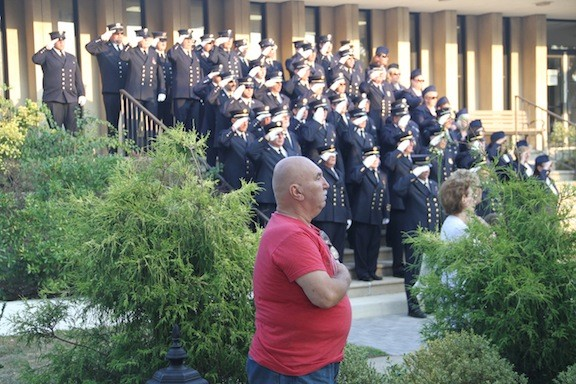 "Ed Coghlan recited the ""Pledge of Allegiance"" as residents and Lynbrook Fire Department volunteers saluted or held their hands over their hearts."