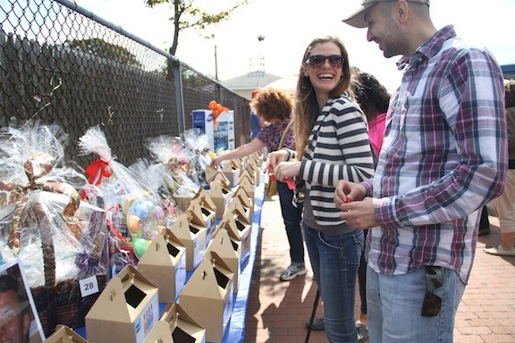 Andrea Leconte and Kamran Khan looked over the raffle baskets.