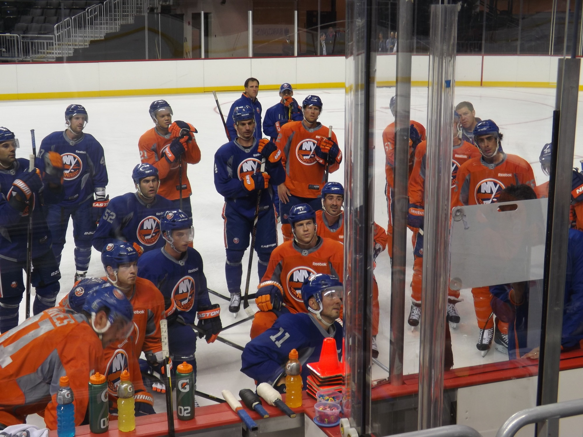 Islanders players watched as head coach Jack Capuano drew up the next drill.