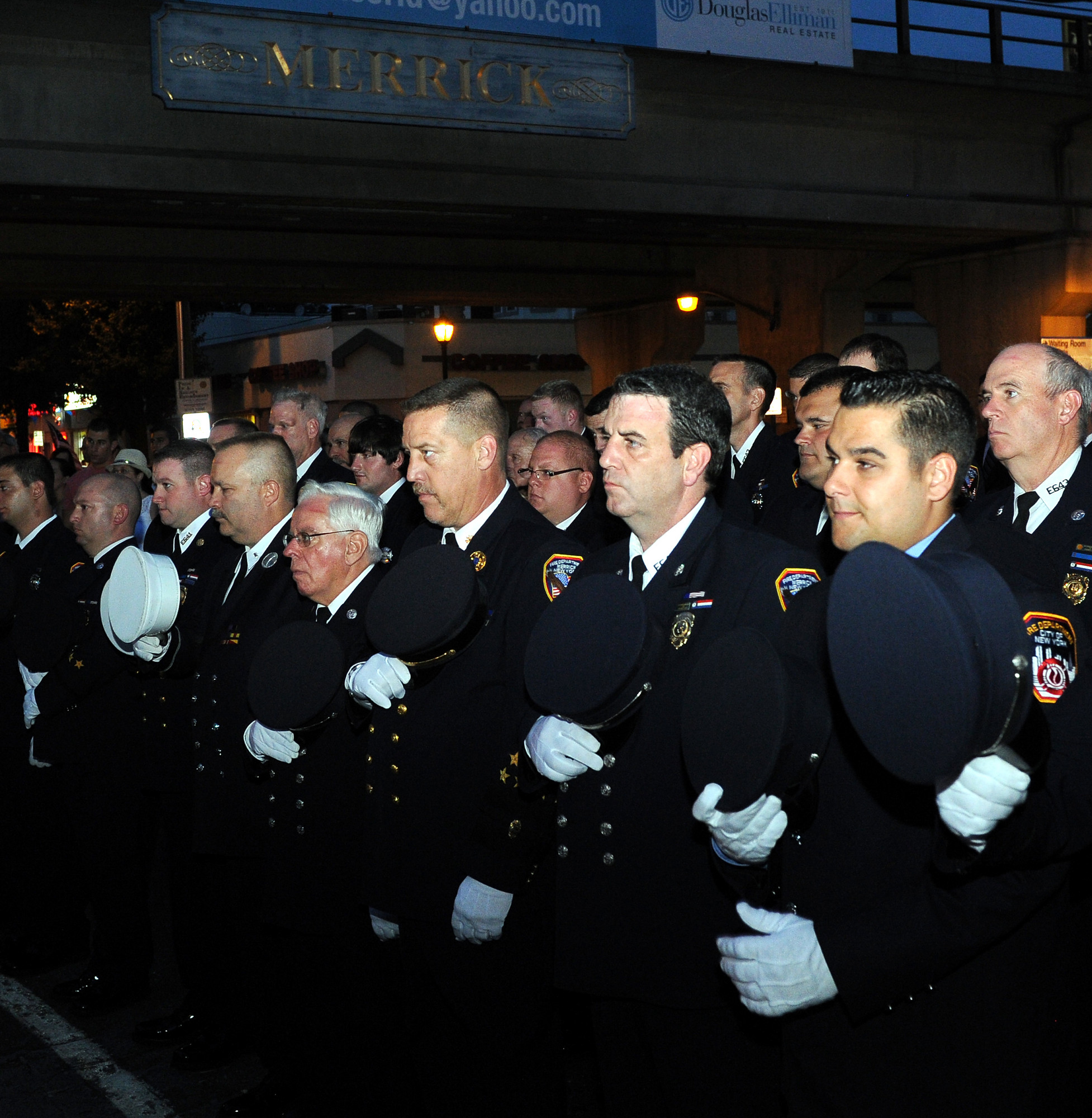 Merrick Fire Department members removed their caps during the service.