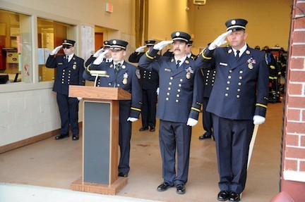 Chief Christopher O'Brien, First Assistant Chief Stephen Marsar and Second Assistant Chief Daniel Holl offered a solemn salute to the department's Sept. 11 heroes.