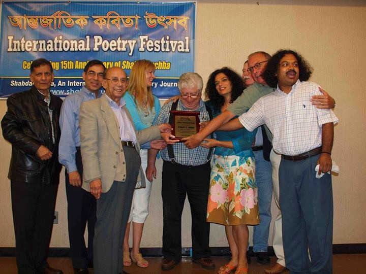 Merokean Stanley Barkan receiving the Shabdaguchha Poetry Journal's Lifetime Achievement Award in August at the Queens Library in Jamaica.