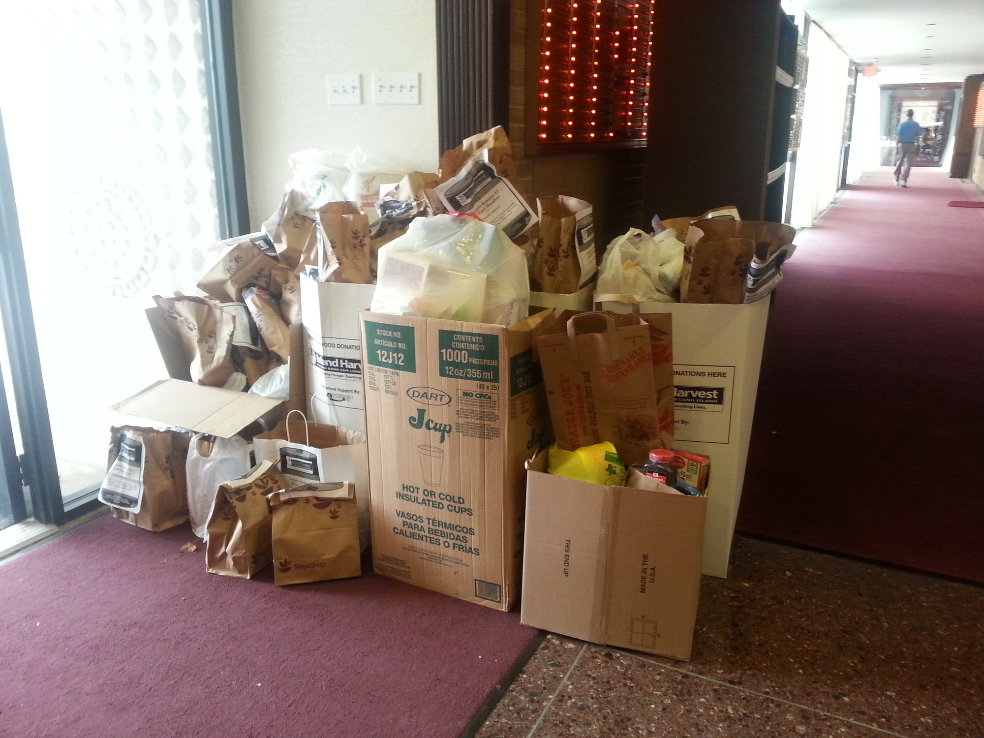 Boxes of food in the lobby of Temple Emanu-El. At the end of the month, it will be delivered to Island Harvest.